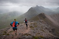 TORRIDON, SCOTLAND - 28 JUNE 2014: Olof Häggström and Johan Hasselmark leaving the summit of Spidean Coire nan Clach on Beinn Eighe during the 42km run leg of the Celtman Extreme Scottish Triathlon