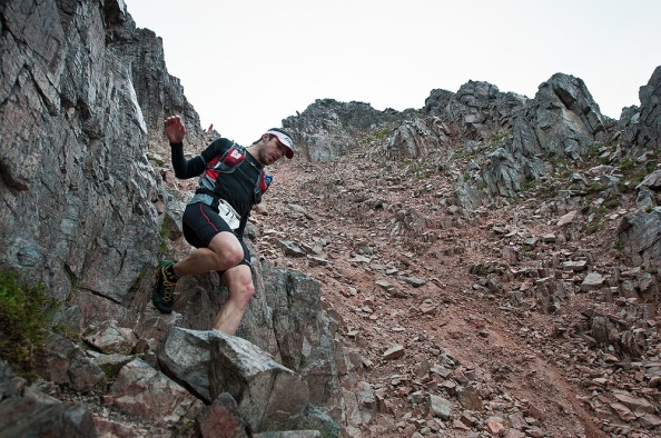 TORRIDON, SCOTLAND - 28 JUNE 2014: Chris Stirling descending the scree gully on Beinn Eighe during the 42km run leg of the Celtman Extreme Scottish Triathlon